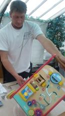 Repairer fixing a wooden baby walker